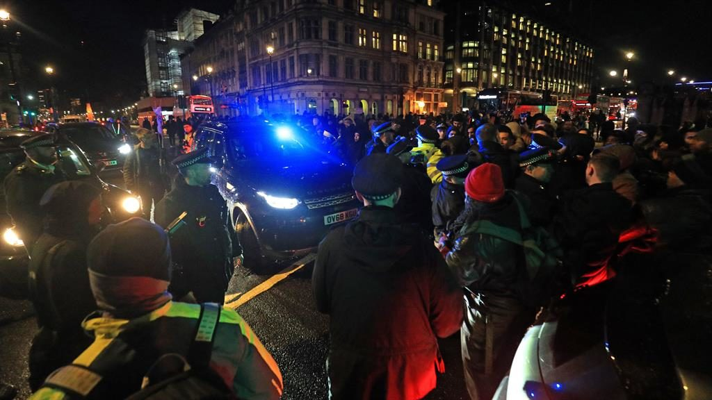 Show of support: Protesters gather in Parliament Square to demonstrate against the deportation flight PICTURE: PA