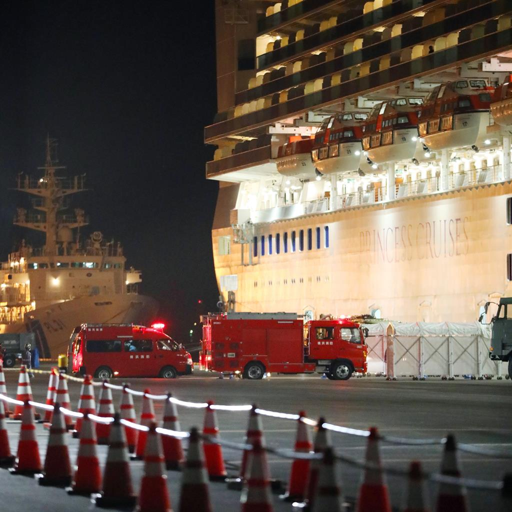 Red alert: Emergency workers arrive at the Diamond Princess in Japan PICTURE: EPA/JIJI PRESS