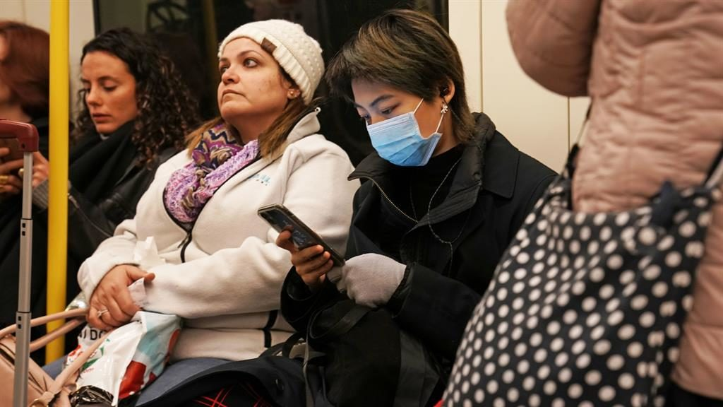 Precautions: A woman wearing a face mask on the London Underground PICTURES: PA/AP