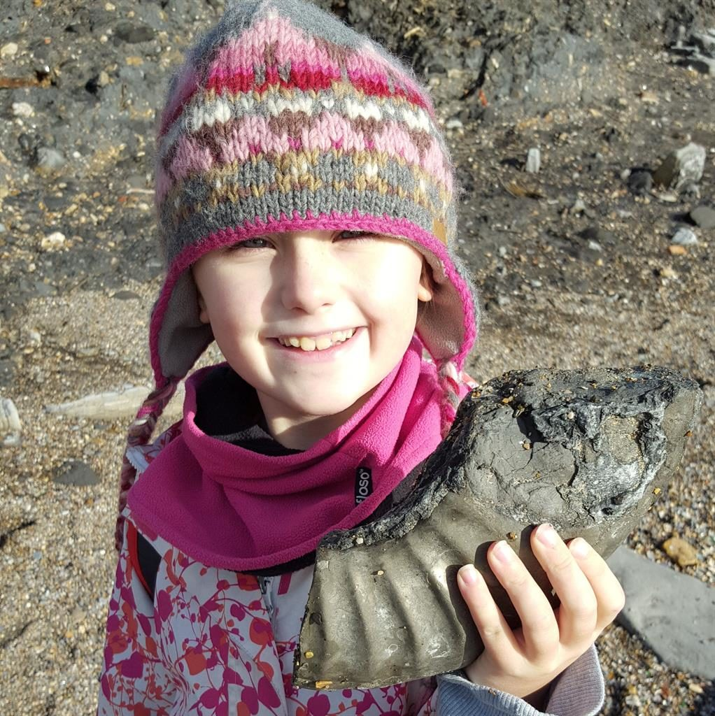 Jurassic lark: Amelie with a fossil she found on shoreline at Lyme Regis PICTURE: SWNS