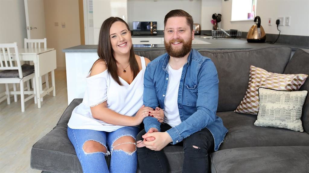 Riding high: Lucy and Josh in their new apartment at Hyde New Homes' New Wave  development