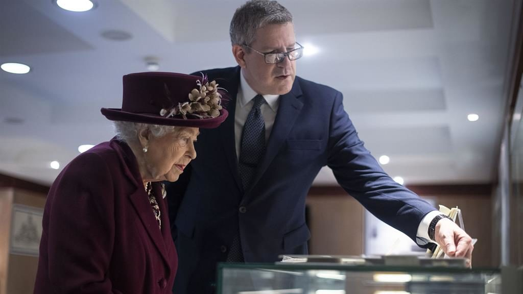 Medals of honour: The Queen is shown some of the D-Day artefacts in the MI5 museum by spy  chief Sir Andrew Parker PICTURES: PA