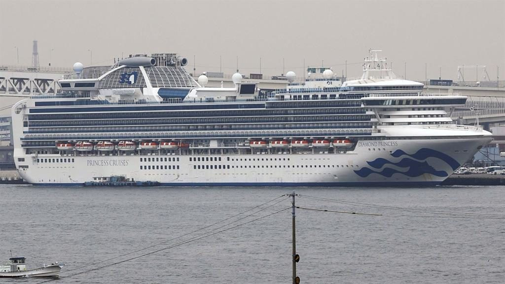 Floating prison: The Diamond Princess cruise ship, where passengers have been quarantined, is anchored at a port in Yokohama, Japan PICTURE: AP