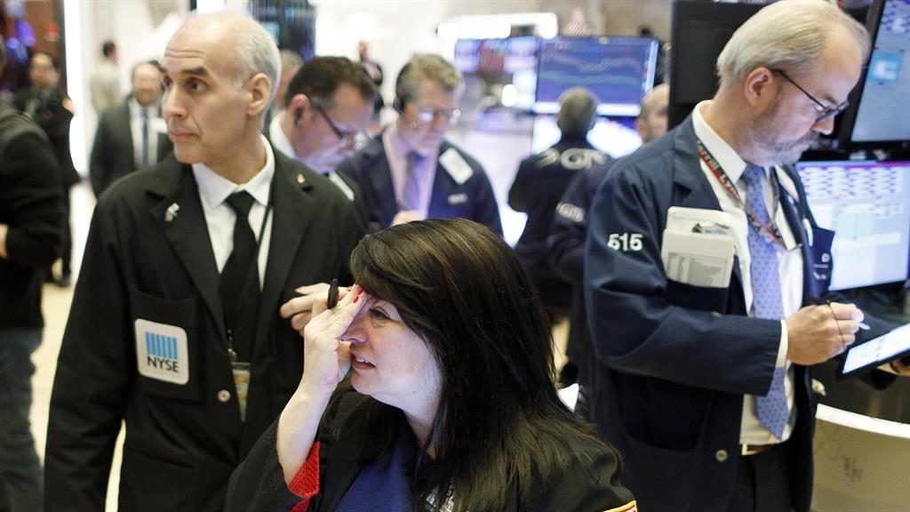 Tense: Traders on the floor in New York PICTURE: EPA
