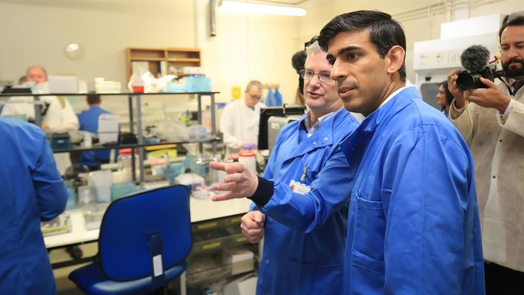 Battling virus: Rishi Sunak is shown the pathology lab at Leeds General Infirmary by Dr Antony Hale PICTURE: PA