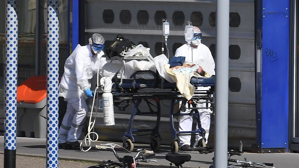 Emergency: A patient is taken to Strasbourg University Hospital by medics PICTURES: AFP/ GETTY