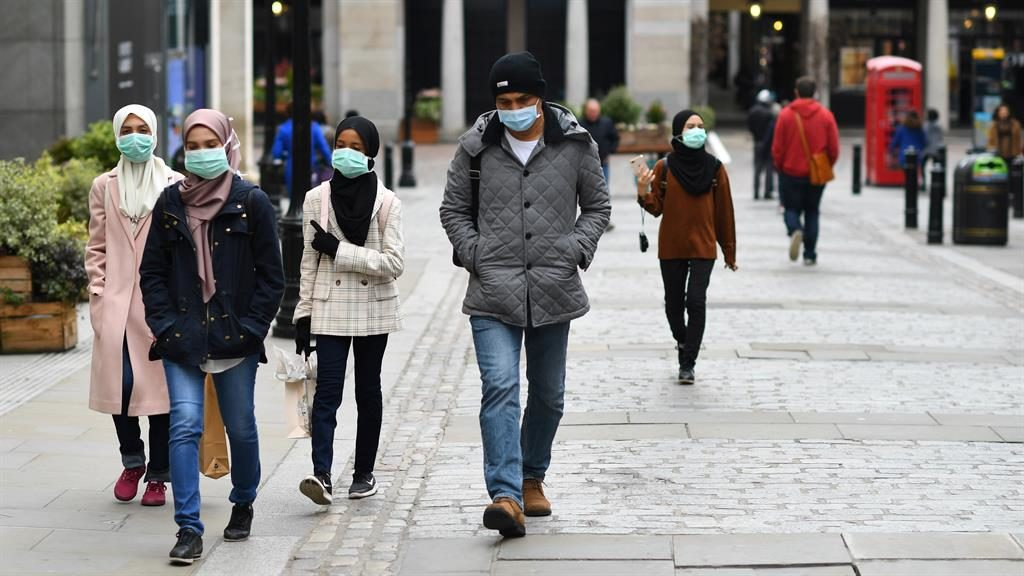Masks: People in central London PICTURE: REUTERS