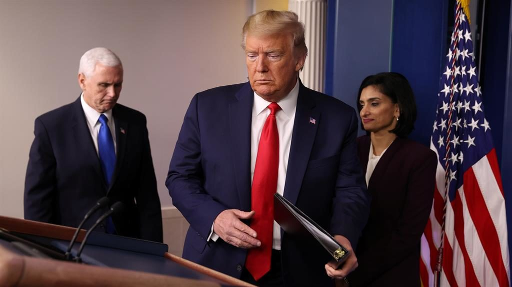 Hope: Donald Trump at his White House press briefing yesterday PICTURE: REUTERS