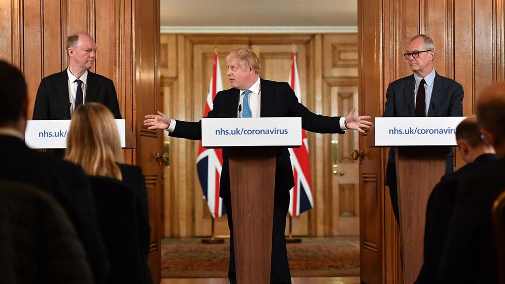 Team effort: Boris Johnson at briefing with Chris Whitty (left) and Sir Patrick Vallance PICTURE: EPA