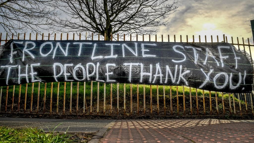 Heartfelt thanks: A banner supports NHS staff outside Salford Royal Hospital in Manchester PICTURE: GETTY