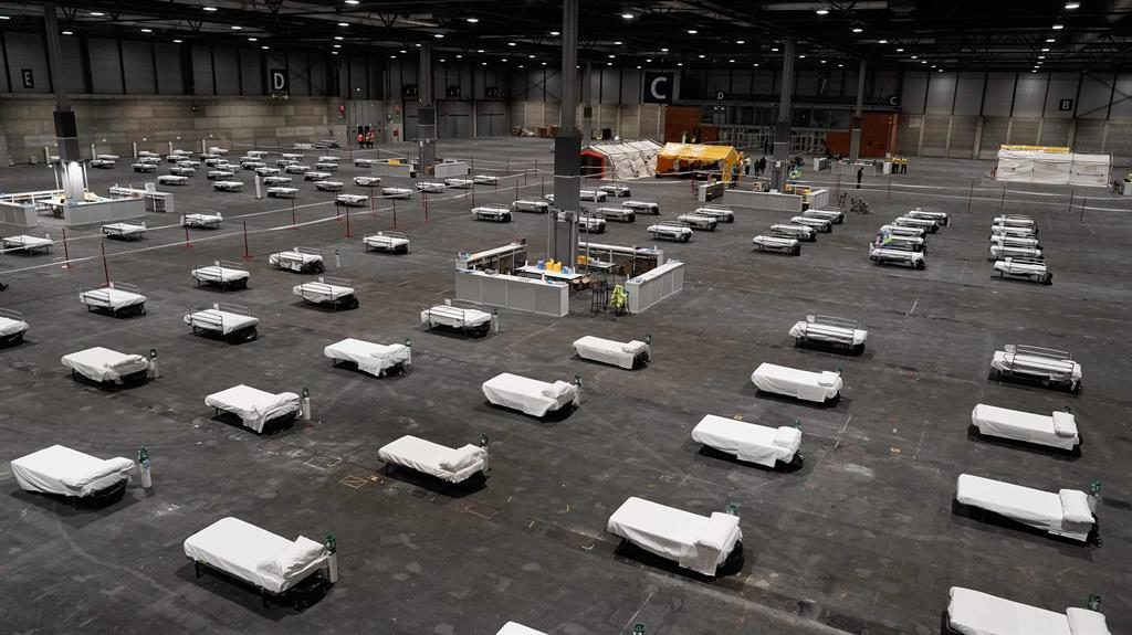 Temporary hospital: Row upon row of beds in a conference centre in Madrid PICTURE: AFP