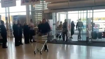 Trolley dash: Employees wait as the doors open for NHS staff at the Tesco Extra in Swansea PICTURES: MEDIA WALES