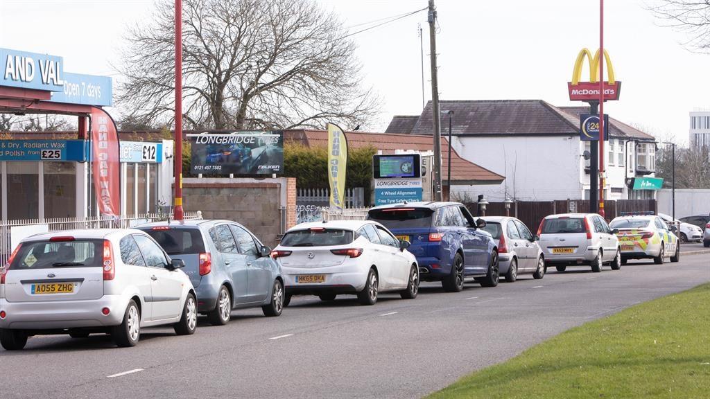 Last food: Drivers queue outside McDonald's in Longbridge, Birmingham PICTURE: SWNS