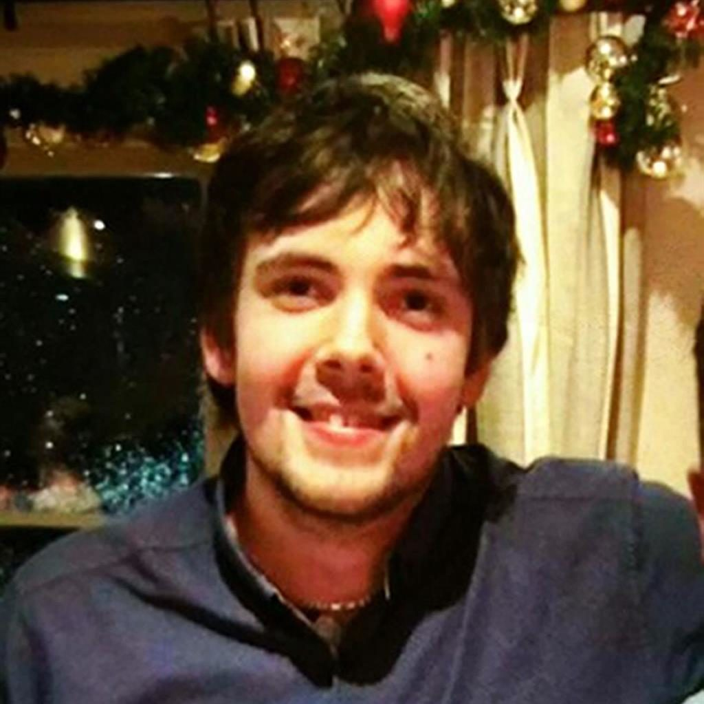 Killed: Alex Davies was found dead in woods PICTURE: PA