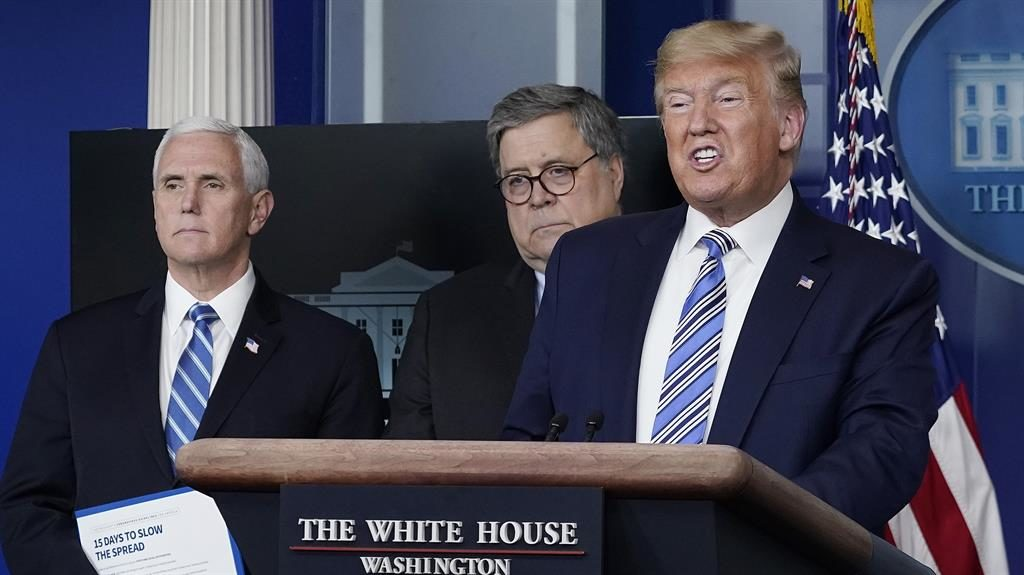 Defiant: Mr Trump and vice president Mike Pence, left, address reporters PICTURE: GETTY
