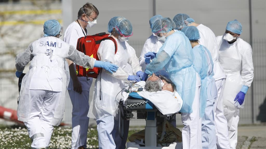 Crisis: A patient is evacuated from Mulhouse's hospital in the Grand Est region, now the virus epicentre in France PICTURES: AP