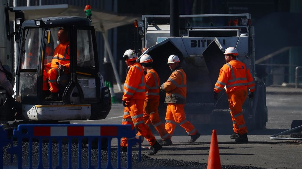 Safety fears: Construction workers at a site in London yesterday PICTURE: REUTERS