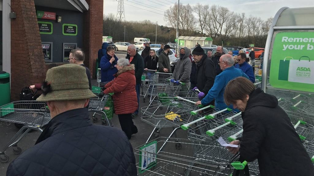 Closing in: Shoppers clustered outside a Newcastle branch of Asda yesterday PICTURE: NORTH NEWS
