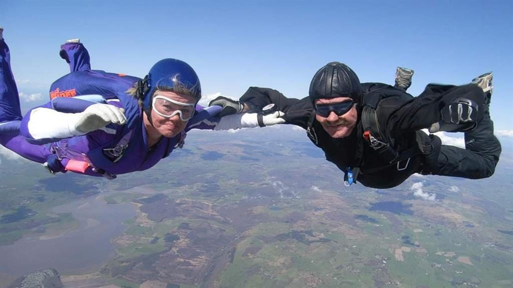 The only way is down: George McGuinness, right, skydiving with his wife Geraldine  PICS: SWNS