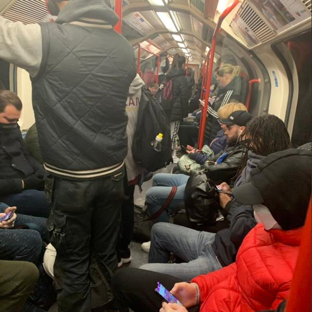 Tube strain: No chance of obeying the two-metre rule on this packed Underground train yesterday