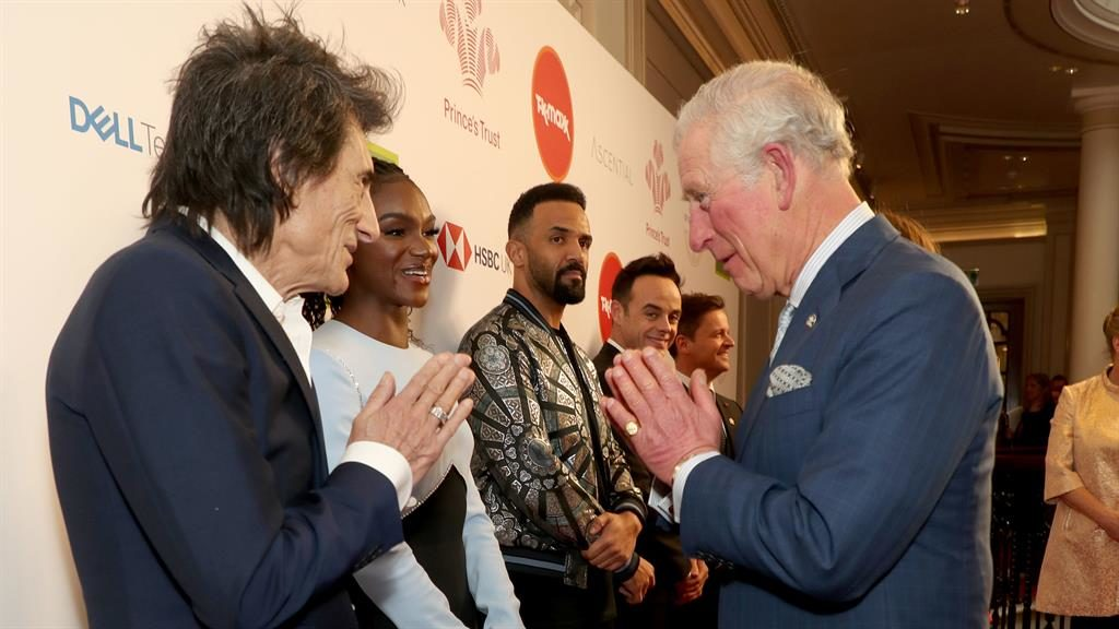 Namaste to see you: Charles, 71, meets Ronnie Wood at Prince's Trust do PICTURE: PA