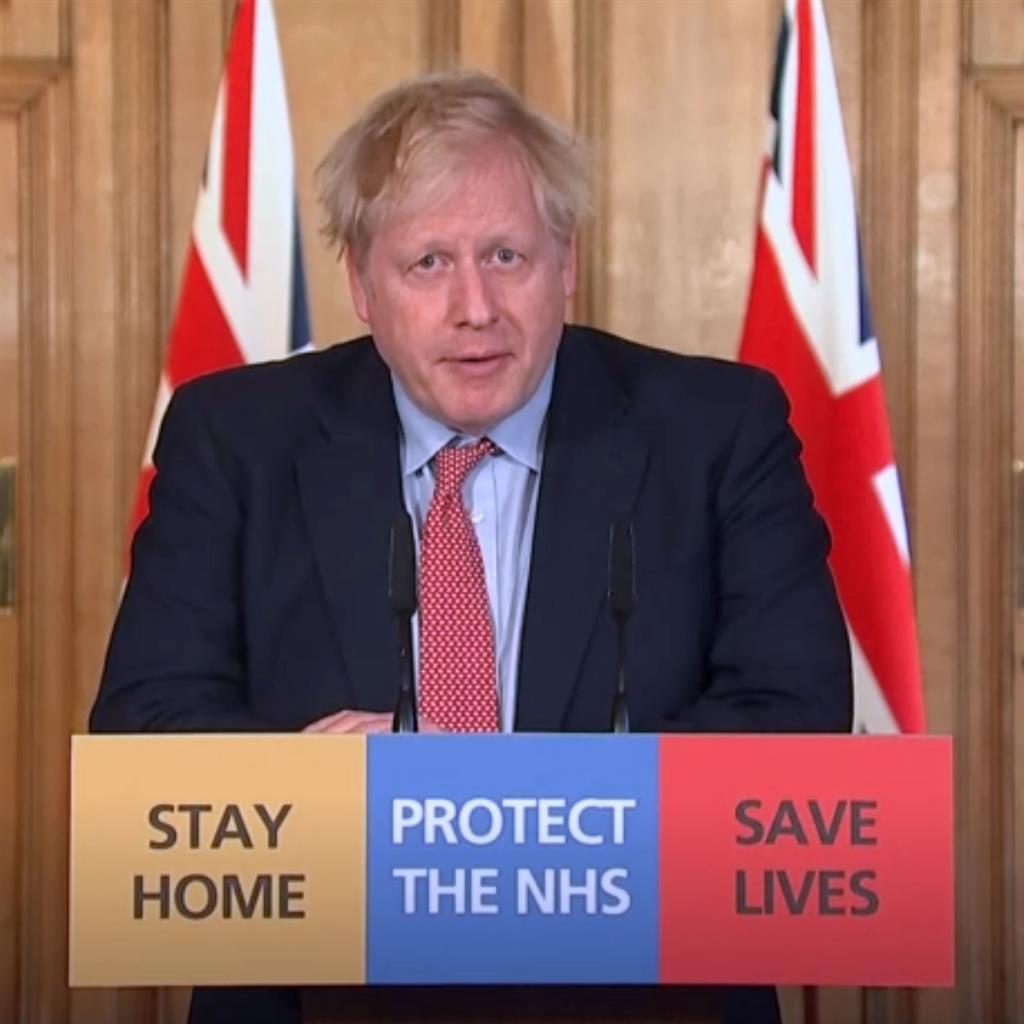 Delight: Boris Johnson briefs media PICTURE: PA