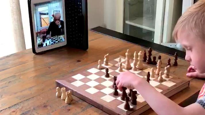 Squaring up: Ruben's chess game with his self-isolating grandfather Mick PICTURE: SWNS