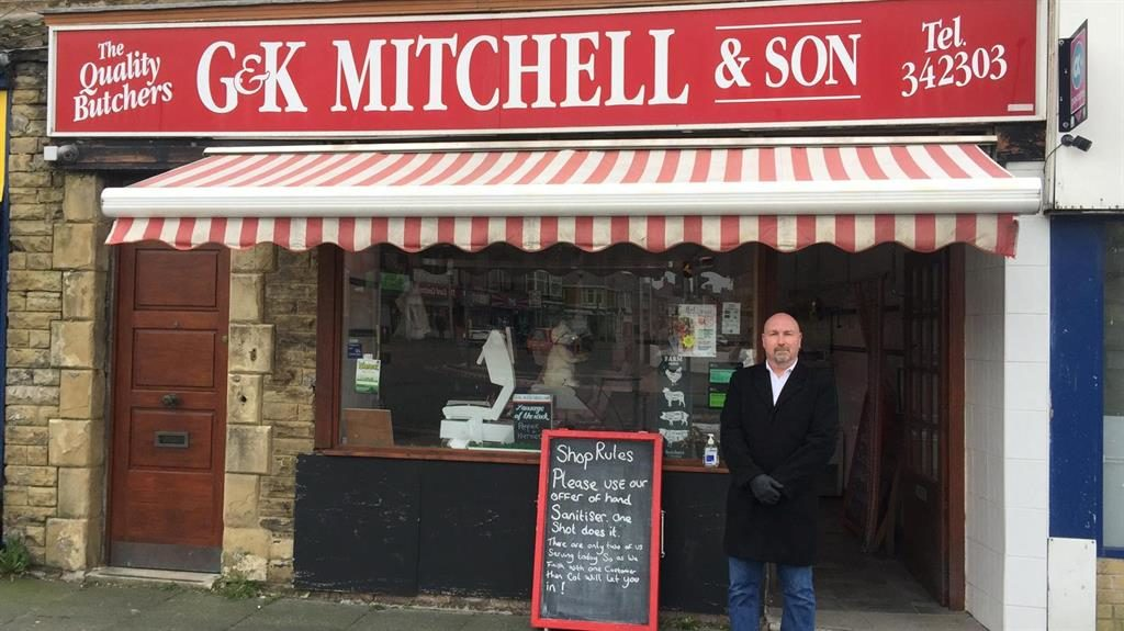 Minding the joint: Matthew Mitchell (below) has had to hire his friend Colin Appleby as a bouncer at his butcher's PICTURE: SWNS