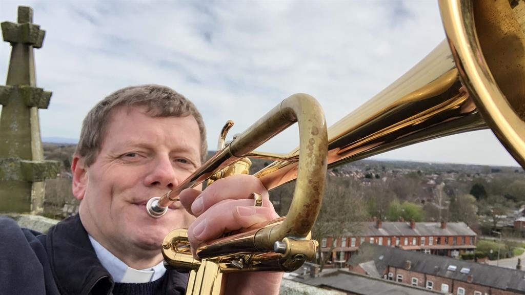 Performance space: Reverend Alan Saunders on top of Christ Church Pennington's tower PICS: SNWS