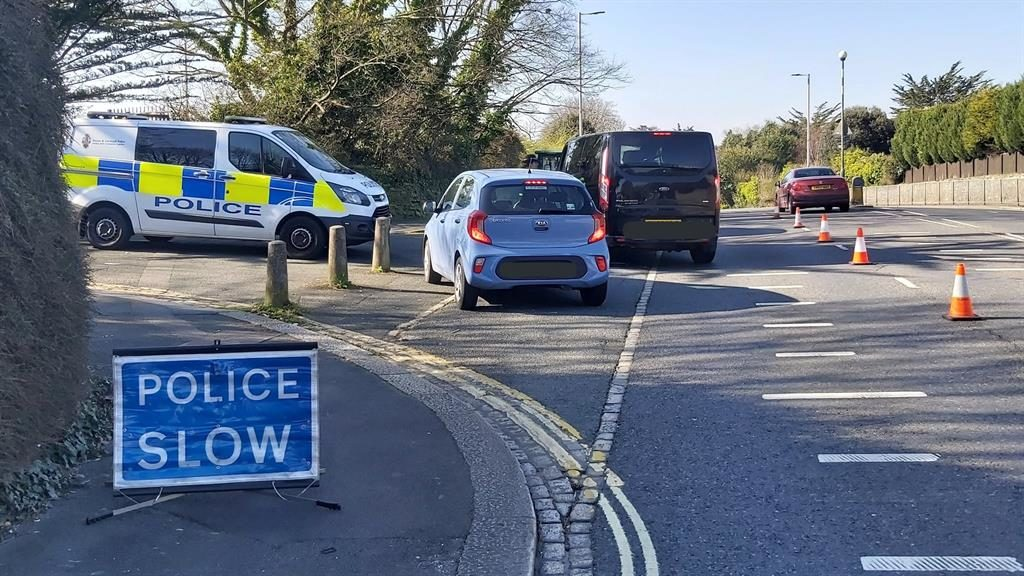 No nonsense: A police checkpoint in Devon and (below) warning sign at West Lulworth, Dorset PICTURES: PA/BNPS
