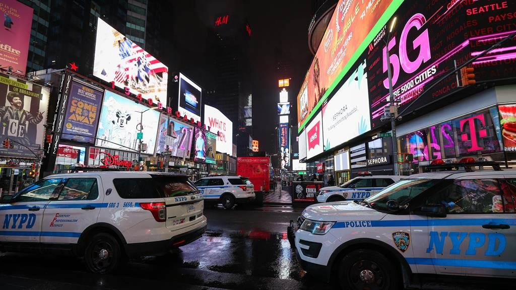 Sign of the Times: Police cars parked in a deserted Times Square, New York PICTURE: GETTY