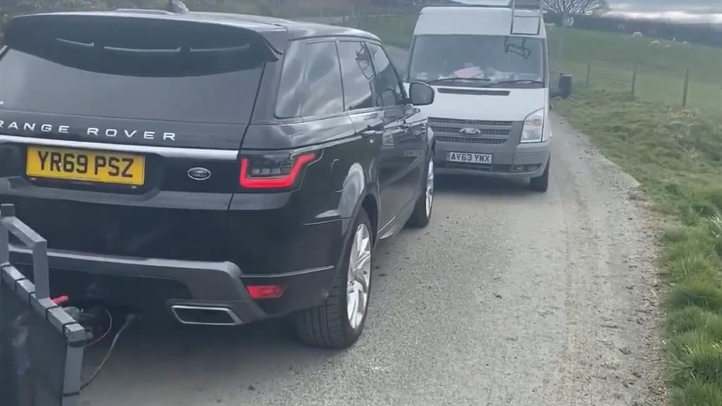 No through road: Locals in Transit van stop Range Rover driver from Sheffield heading into park with trailer tent PICTURE: DAILY POST WALES