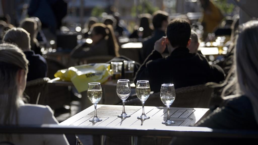 'Surreal calm': People sit at an outdoor restaurant in central Stockholm PICTURE: EPA