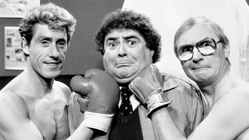 Knockabout humour: Eddie, centre, with The Who's Roger Daltrey and comedy partner Syd Little PICTURES: PA/REX