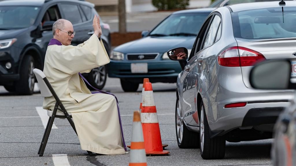 Drive to confess: A priest hears confession in the car park of a church in the US state of Massachusetts PICTURE: REX
