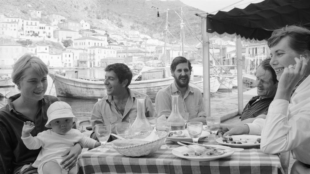 Paradise: Marianne Ihlen and Leonard Cohen (first and second left) relaxing with Charmian Clift and George Johnston (first and second right) and a friend on Hydra in the 1960s. The island today (below)