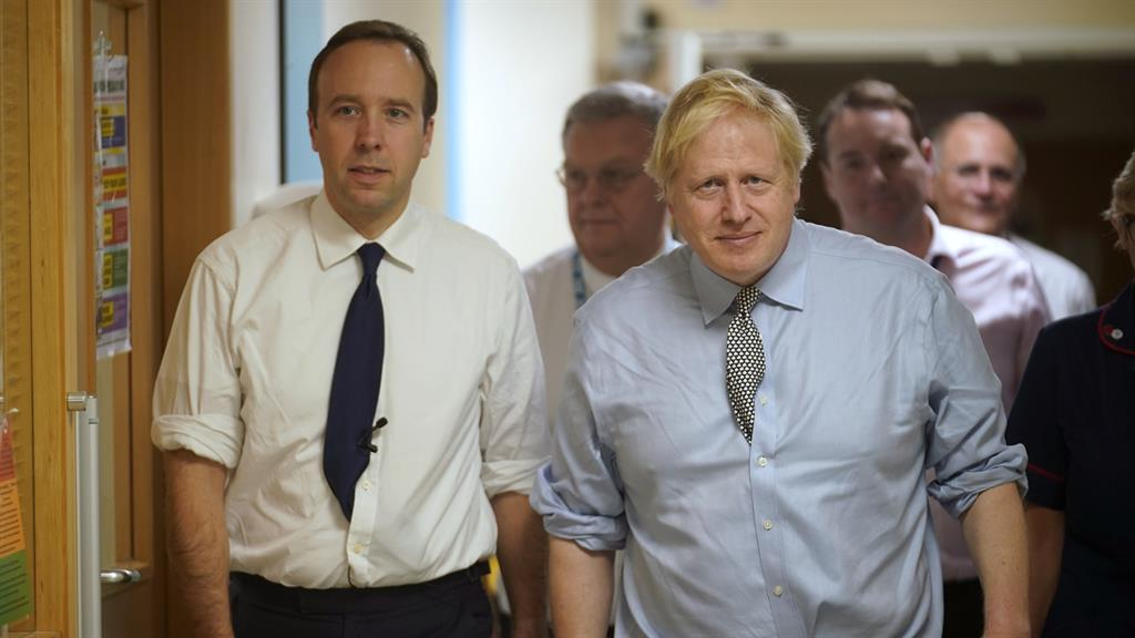 Side by side: Matt Hancock and the PM at a hospital during election campaign PICTURE: GETTY