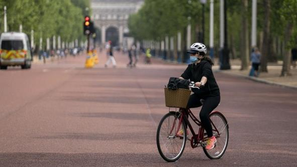 Changing habits: A cyclist rides in The Mall PICTURE: EPA-EFE/WILL OLIVER