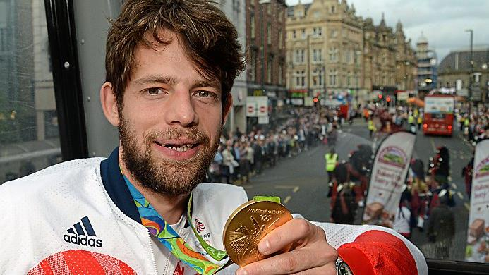 Golden boy: Ransley shows off his medal at the British team parade in 2016