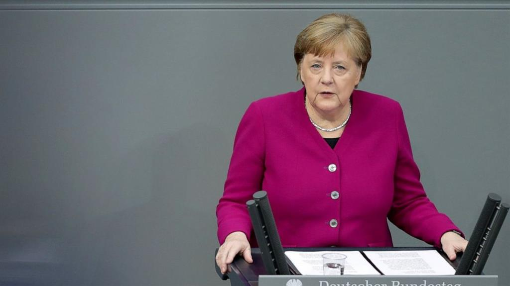 Effectiveness: German chancellor Angela Merkel addresses the federal parliament in Berlin. The country has managed the coronavirus crisis more successfully than its neighbours PICTURE: AP/MICHAEL SOHN