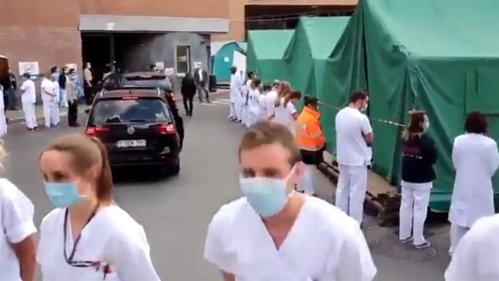 Fighting back: Hospital workers make their feelings known as PM's car passes PICTURE: BRUSSELS TIMES