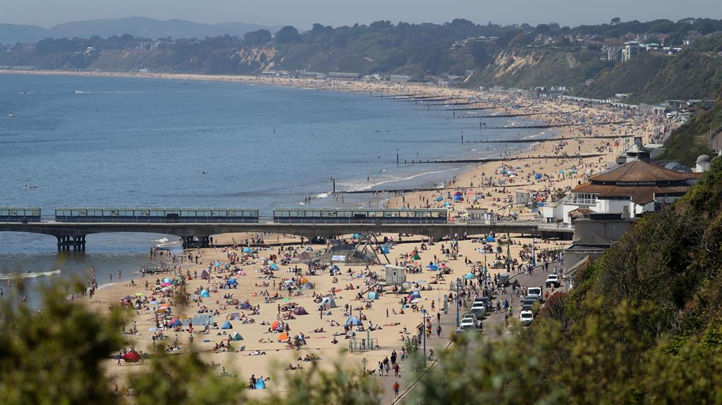 Don't sand so close to me: The beach at Bournemouth is packed with sunseekers, making social distancing difficult PICTURE: PA