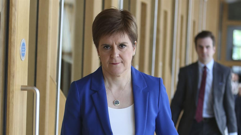 Heading into Holyrood: First Minister Nicola Sturgeon arriving at the Scottish Parliament today PICTURES: PA