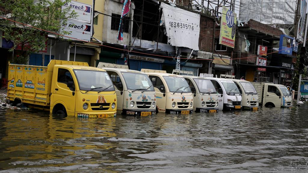 Deluged: Waterlogged trucks in a flooded area of Kolkata after Cyclone Amphan swept through PICTURE: EPA