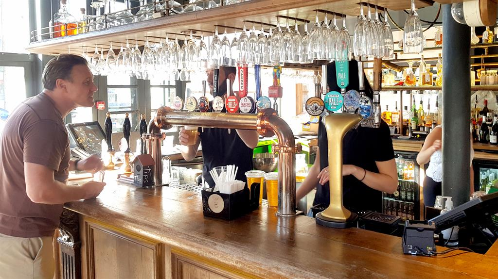 Here's looking at brew: A drinker at the Princess Of Wales in Primrose Hill, London PICTURE: SPLASH