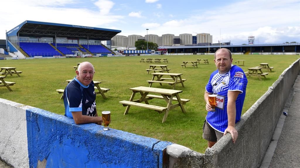Prop up our bar: Club stalwarts Steve Neale (left) and Pete Murphy, inset Twitter appeal for tables PICTURE: SWNS