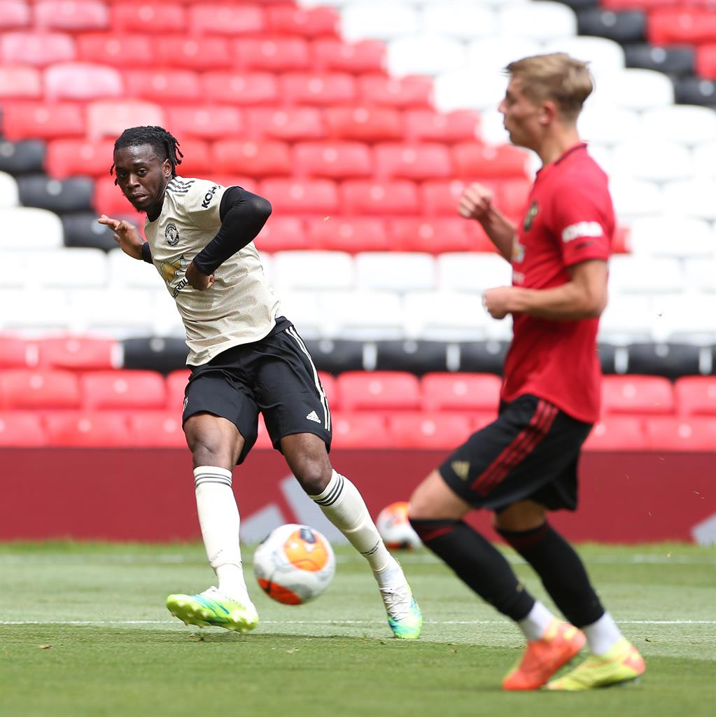 Devil's in the distance: Man United players Brandon Williams and Aaron Wan-Bissaka during a first team training session at Old Trafford PICTURE: GETTY