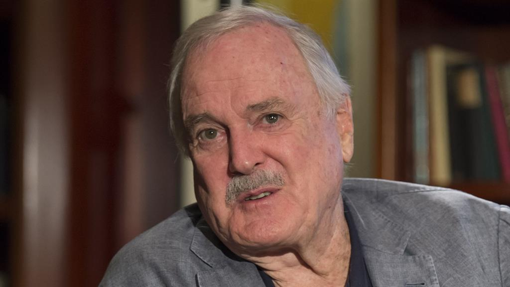 Don't mention it: Cleese insists he was making fun of racism in the episode PICTURES: REX