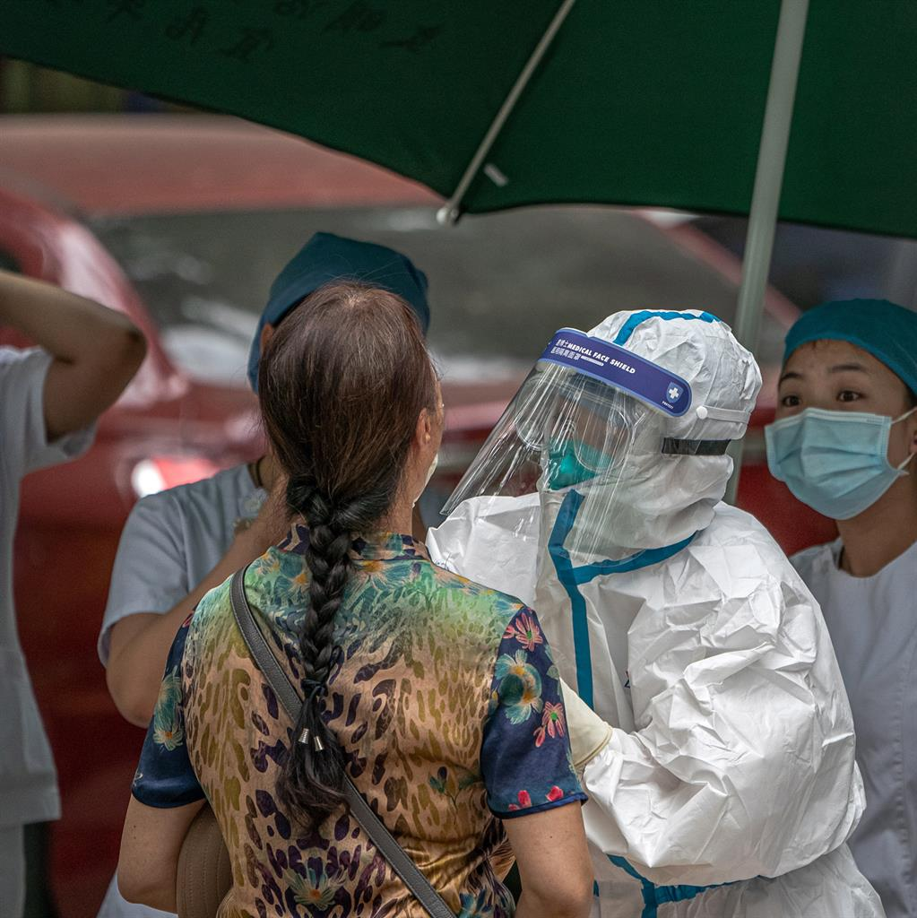 Swab: A woman visits a makeshift testing centre in Beijing yesterday PICTURE: EPA