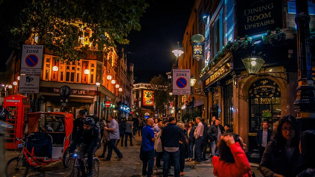 Cheers: People will be allowed to drink outside West End pubs when they reopen PICTURE: ALAMY